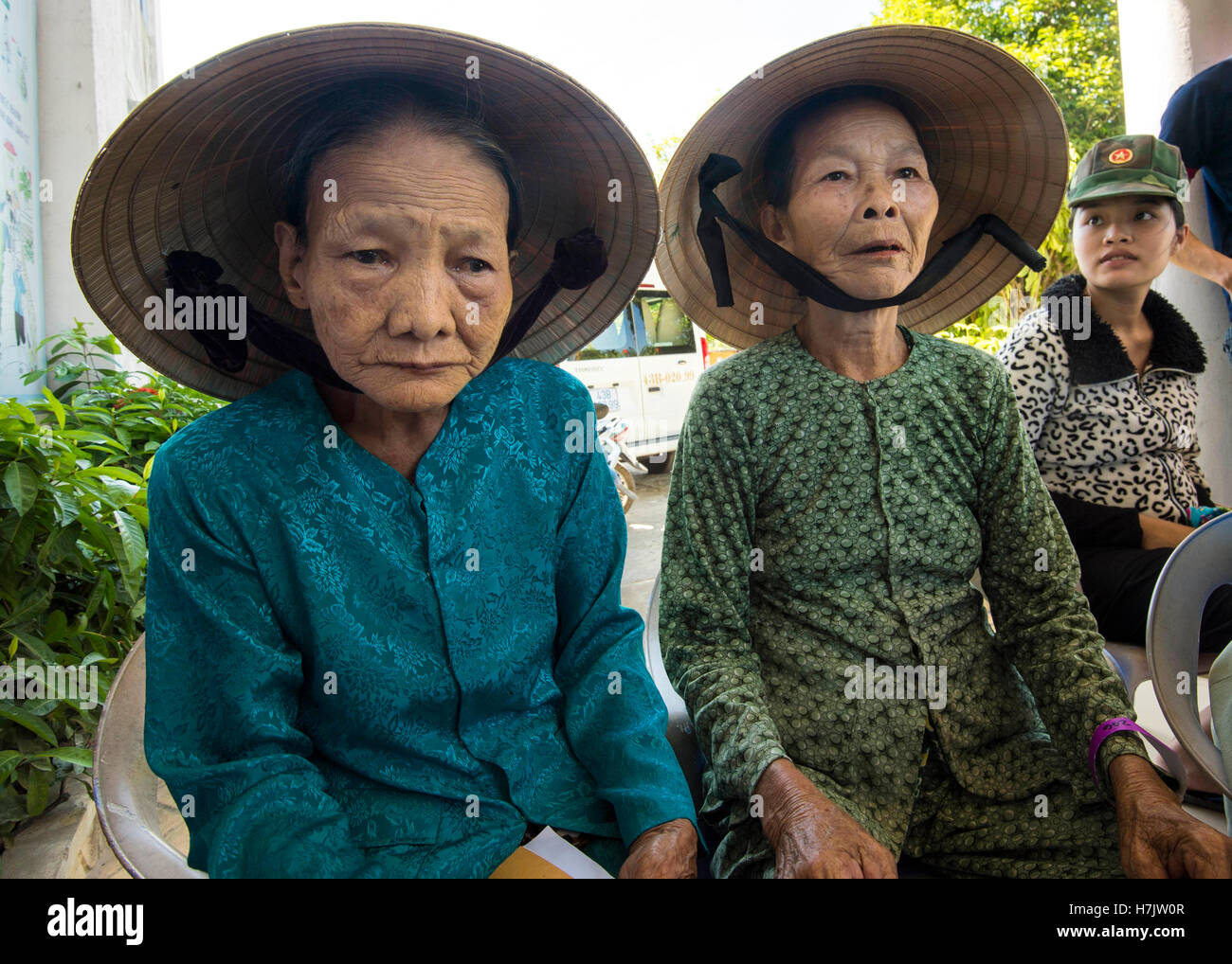 Local Vietnamese women wait to be seen by U.S. military dentists on the USN hospital ship USNS Mercy during a Pacific - Stock Image