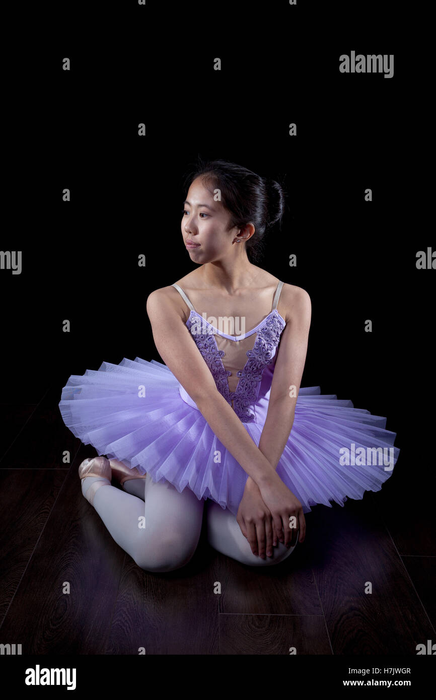 Young Ballerina wearing pointe shoes and tutu in dance pose. Stock Photo