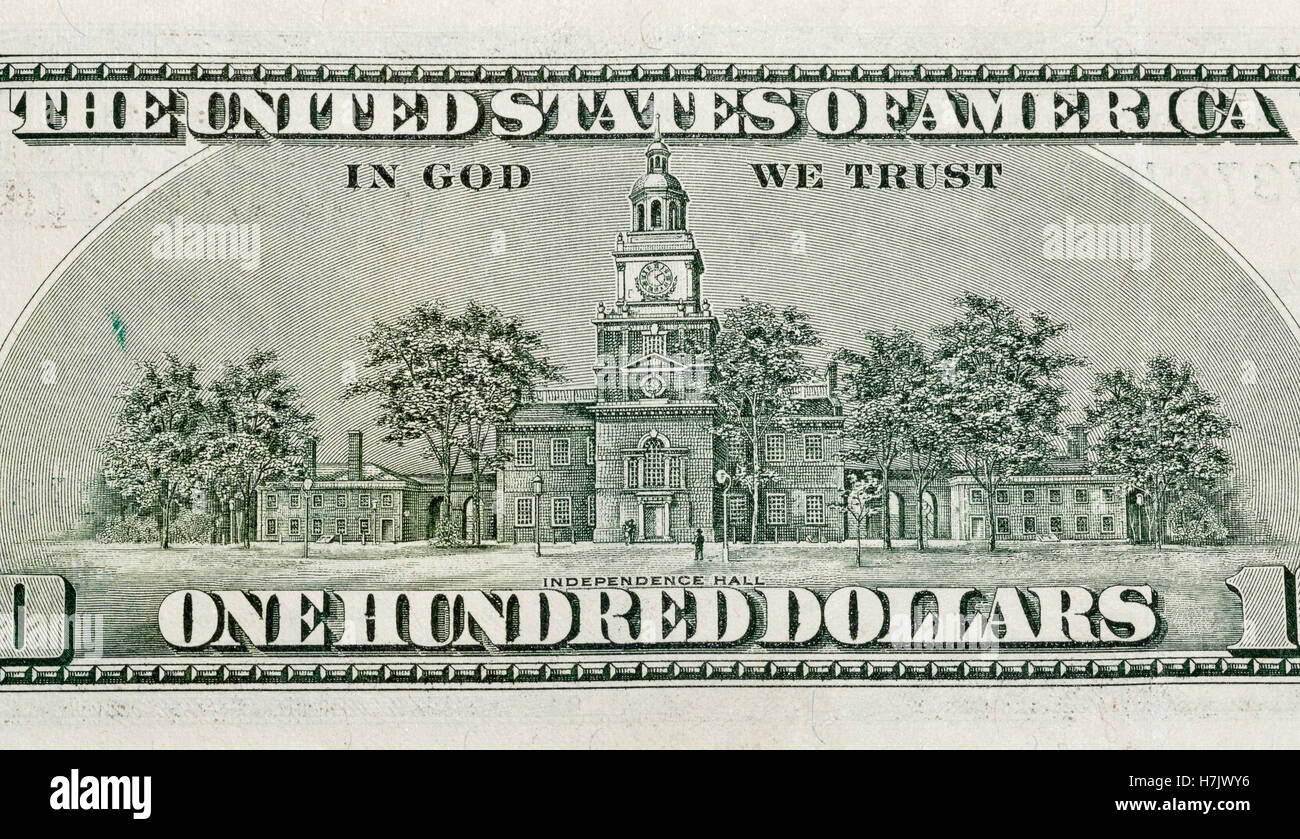 US Independence Hall on back of one hundred dollars bill closeup macro - Stock Image