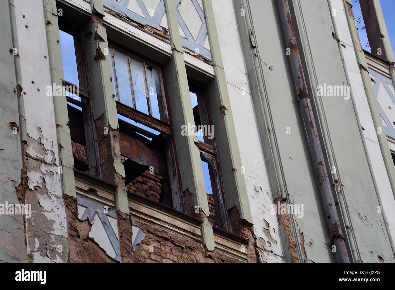 An apartment building in Sarajevo's Old Town remains damaged from the 1992-96 Serbian siege of the city. Stock Photo