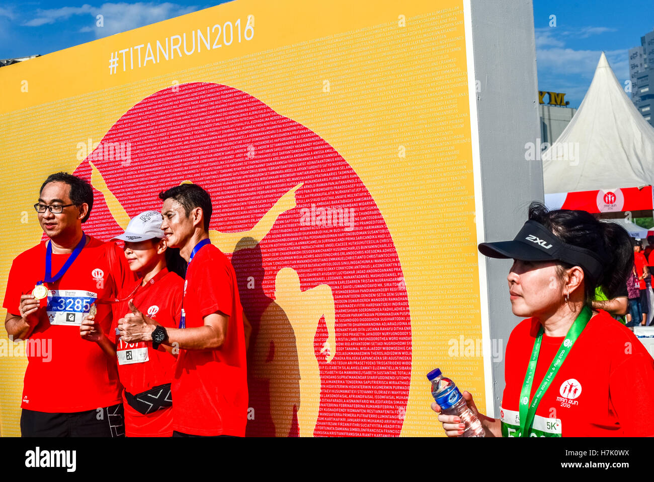 Finishers having photo session with podium backdrop after a race entitled Titan Run in Tangerang, Indonesia. - Stock Image