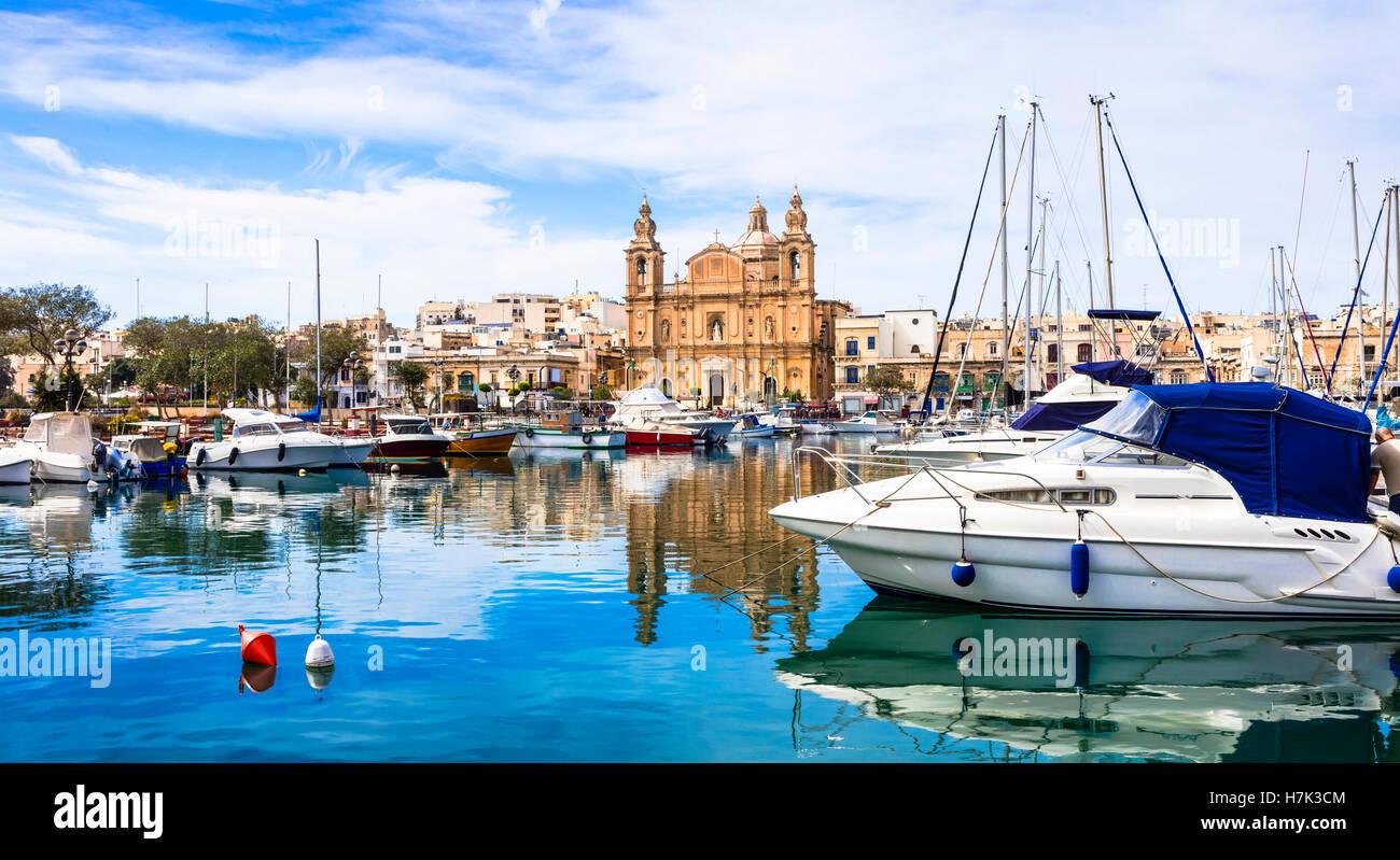 Landmarks of Malta - impressive cathedral Msida and marina in Valletta - Stock Image