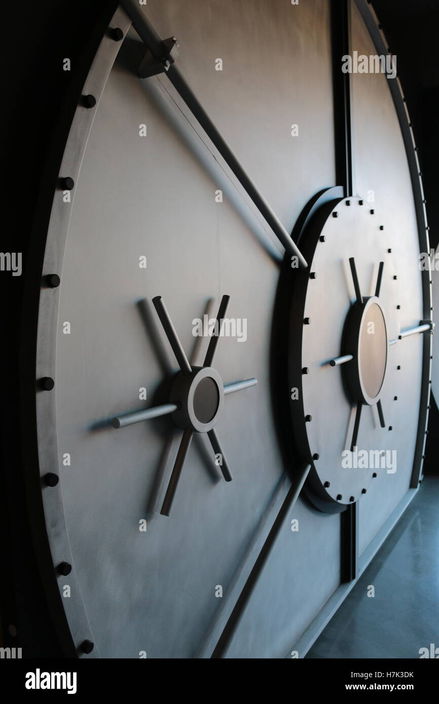 A large steel vault door with large spinners - Stock Image