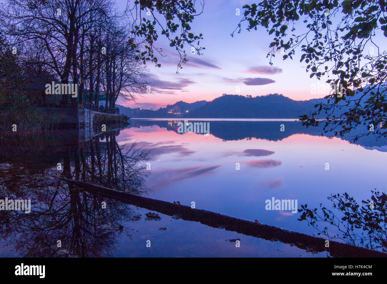 A beautiful autumn blue hour by the lake after the sunset taken at Lago Sirio lake of Ivrea n Chaiverano in Canavese, - Stock Image