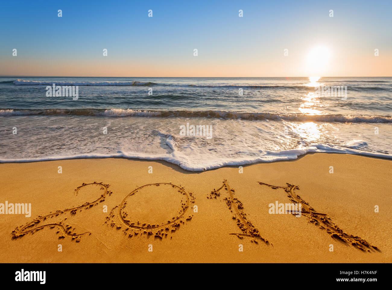 written 2017 on the beach - Stock Image