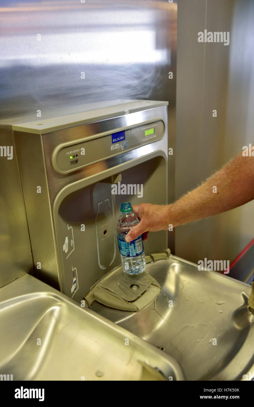 Drinking fountain water refill station, inside security zone of airport - Stock Image