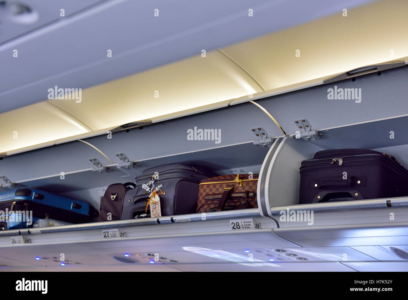 Overhead Locker In Passenger Airplane With Hand Luggage