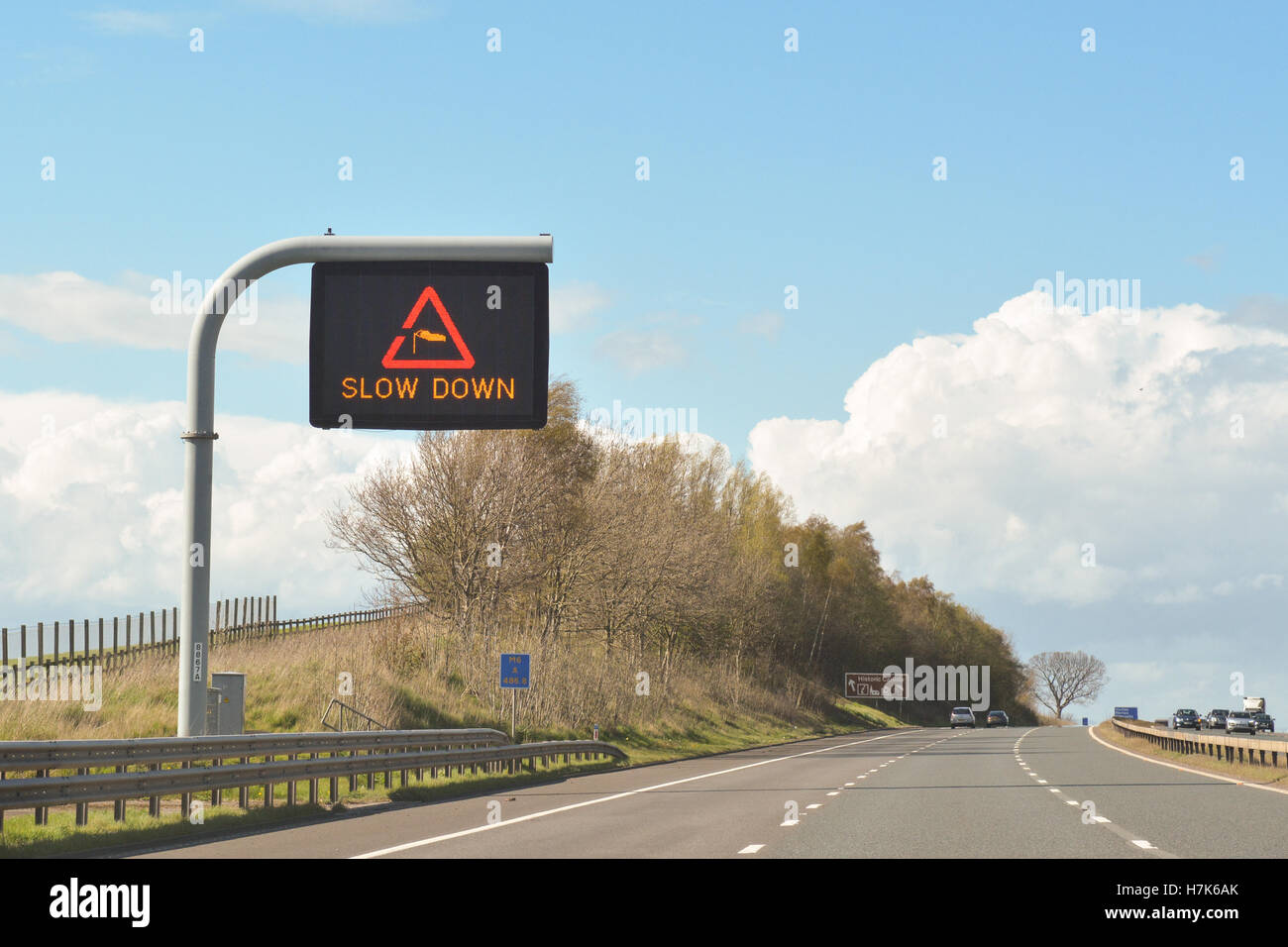 side wind cross wind motorway traffic warning sign - uk - Stock Image