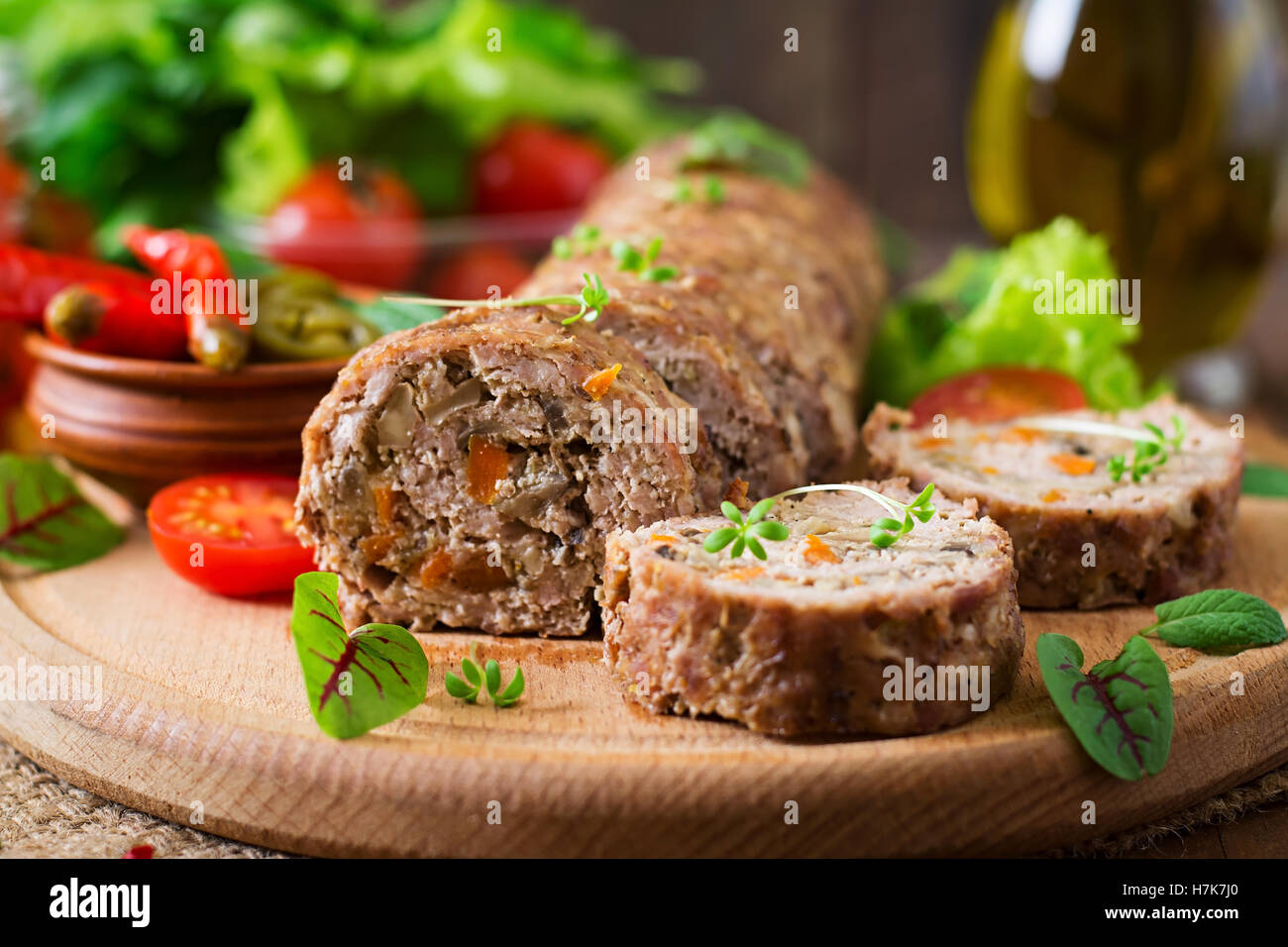 Minced meat loaf roll with mushrooms and carrots - Stock Image