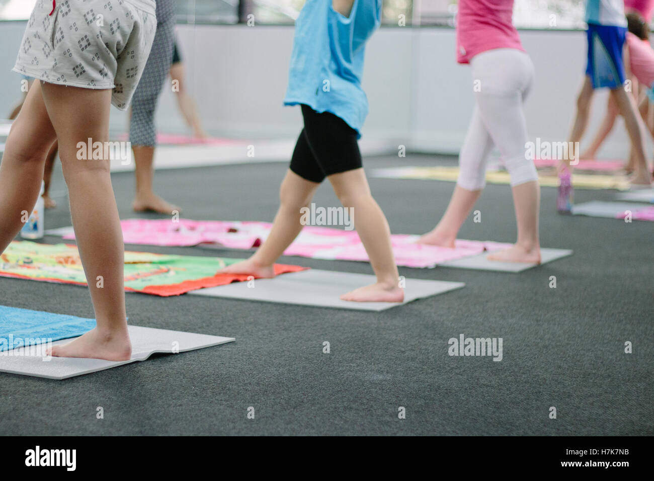 Series of photographs taken in a yoga studio. This image shows a kids yoga class. Stock Photo