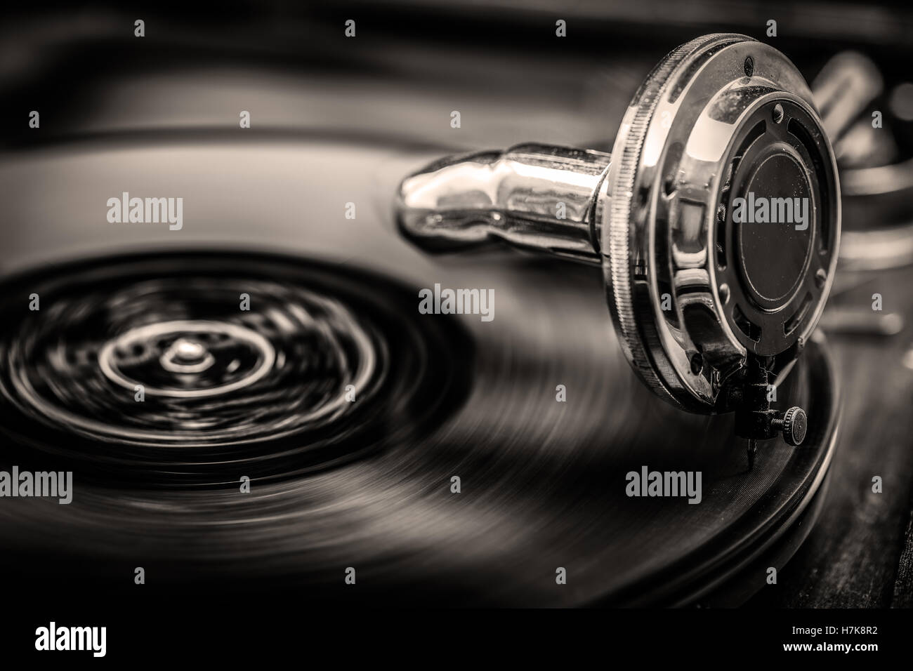 Gramophone playing old disk, old days music, in Sepia Tones, close up shot Stock Photo