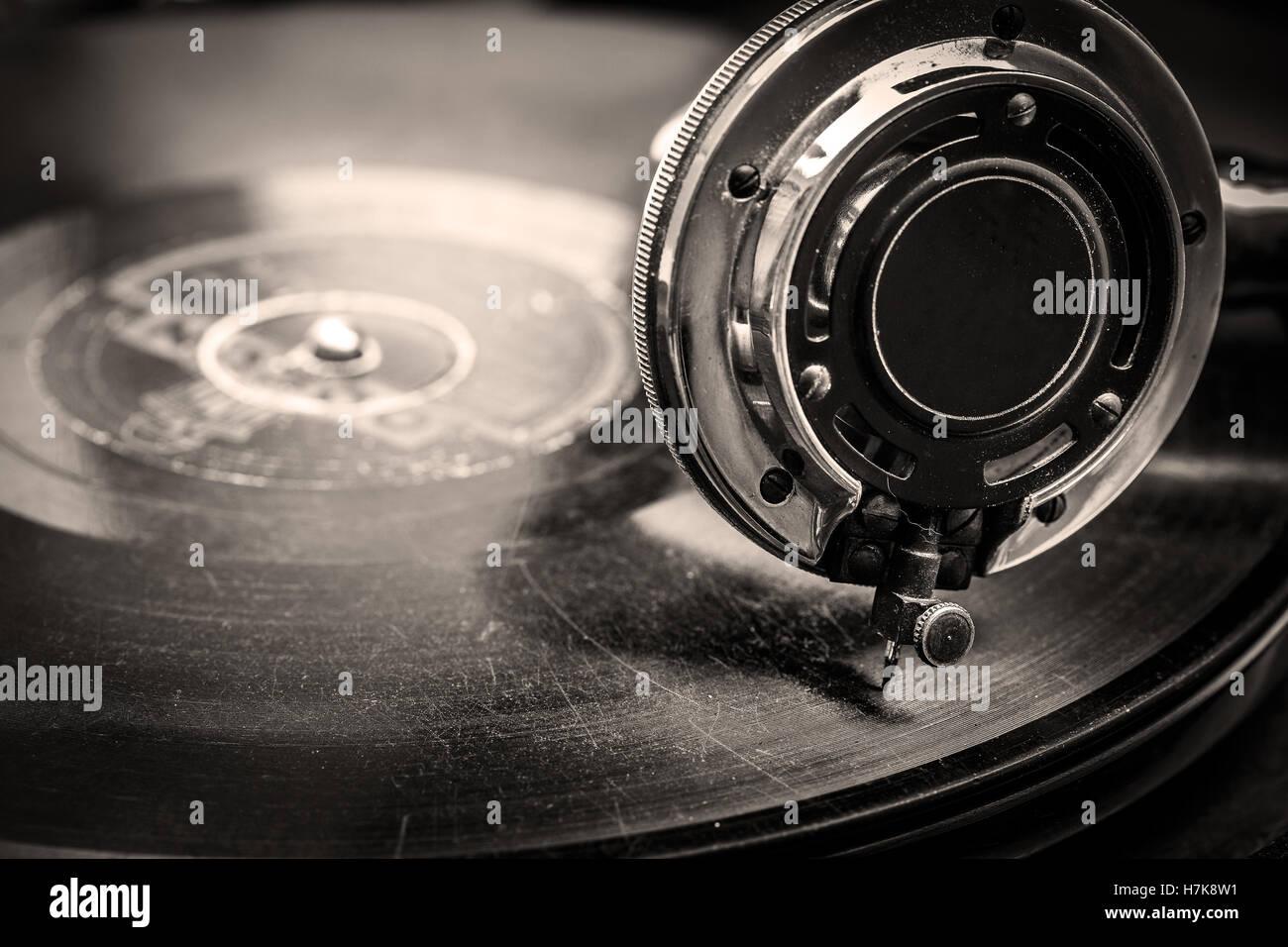 Old, Gramophone playing, close up macro shot in Sepia Tones - Stock Image