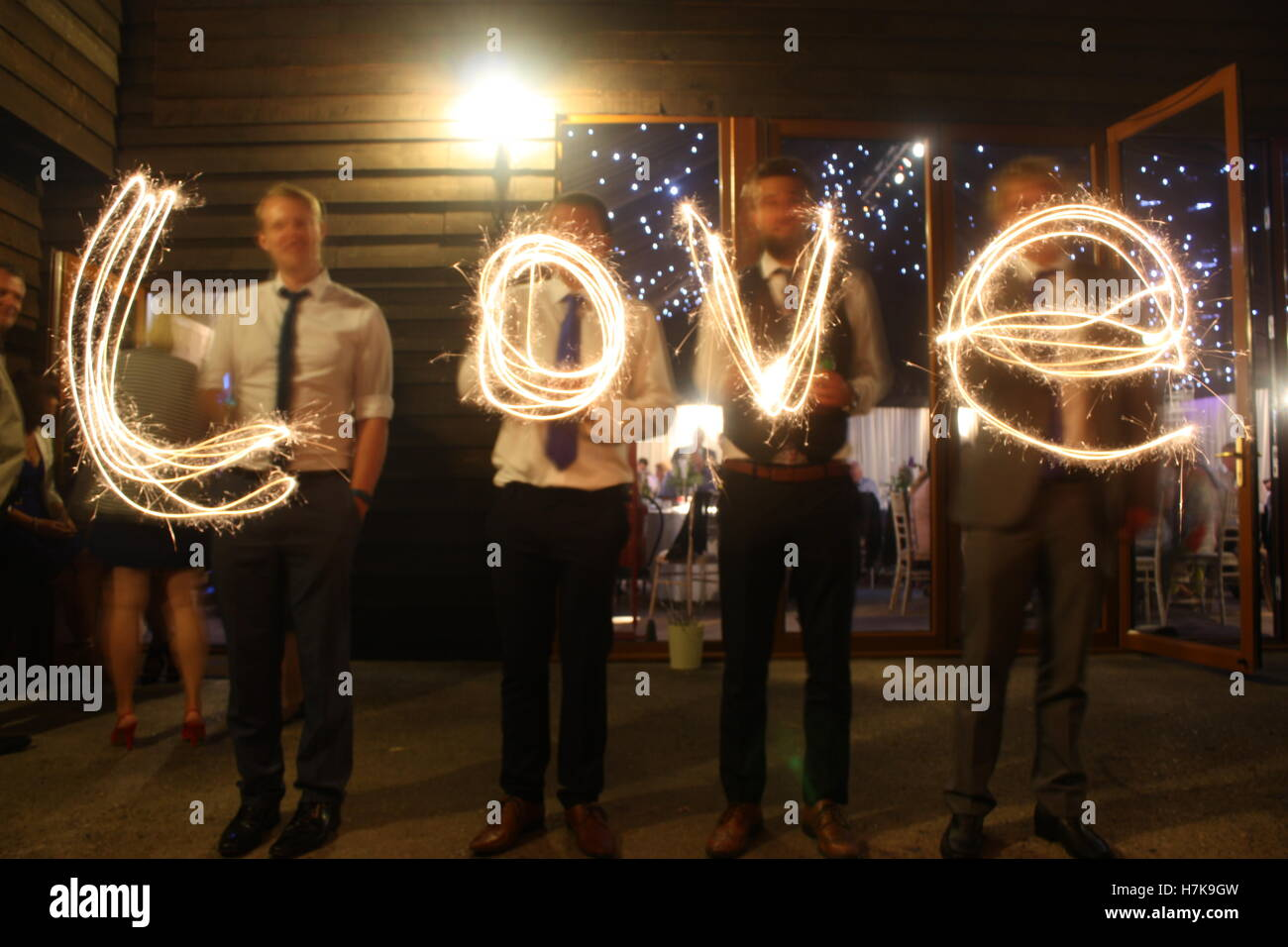 Love written with sparklers at a wedding - Stock Image