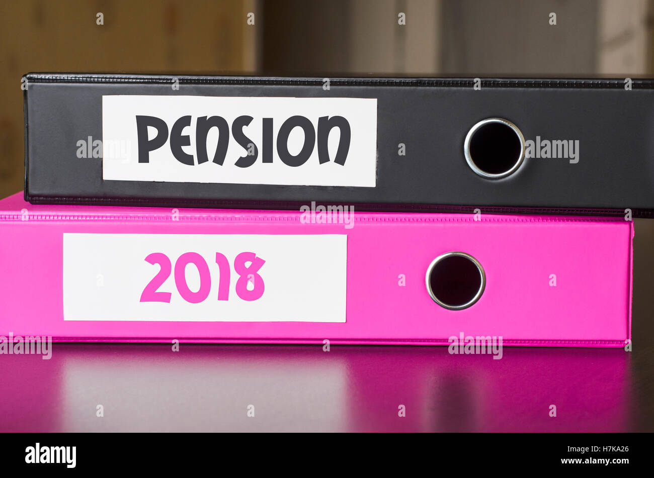 Bright office folders over dark background and pension 2018 text concept Stock Photo