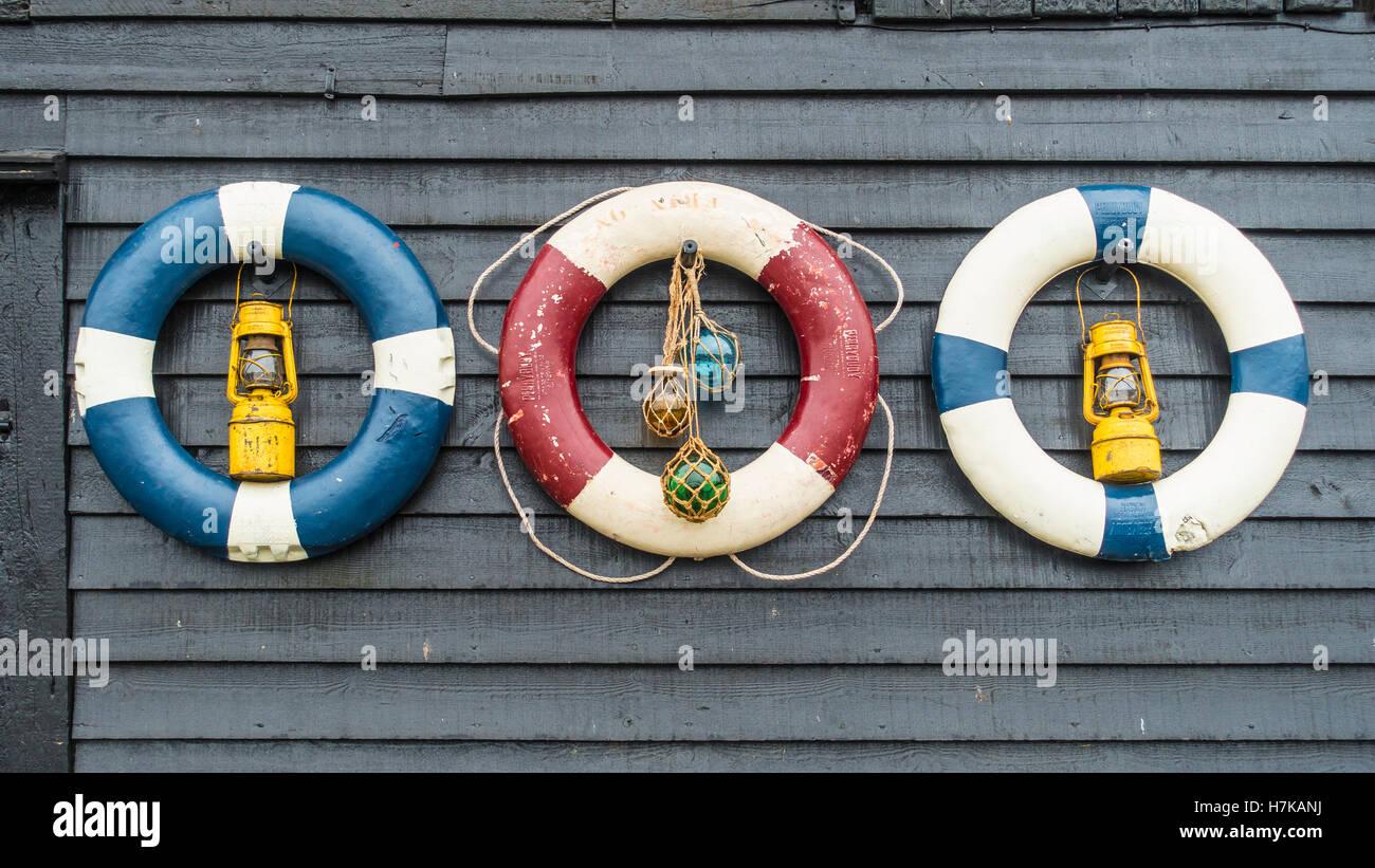 Old Lifebuoys on Tarred Timbers Shiplap Standard Quay Faversham Kent - Stock Image