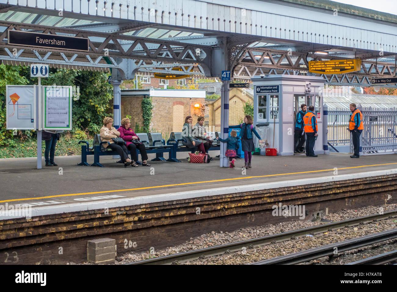 Passengers and Rail Staff Waiting for Train SouthEastern Faversham Station Kent - Stock Image