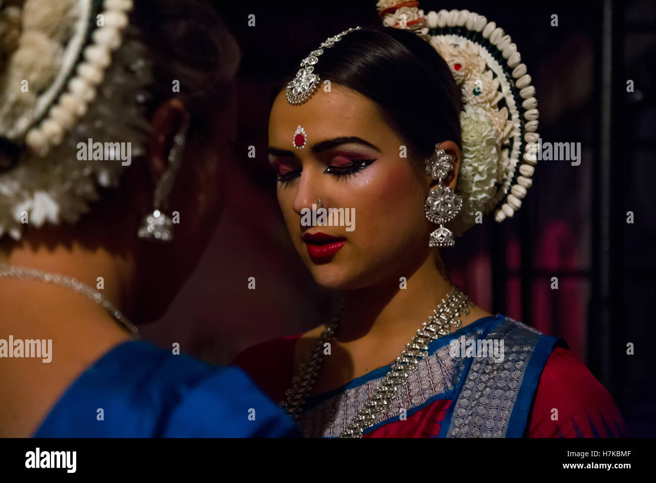 European woman in Indian dress before going on stage during the celebration of Diwali (the Hindu festival of lights) - Stock Image