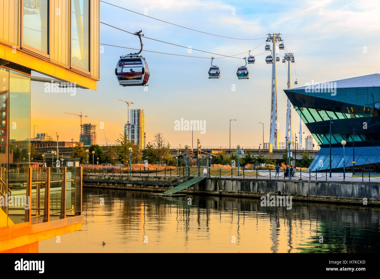 Thames Cable car at Royal Victoria Dock in London at sunset - Stock Image