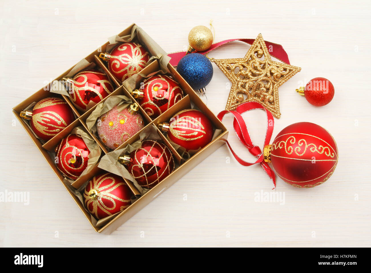 Christmas decorations, baubles in a box, glitter star, ribbon and ...