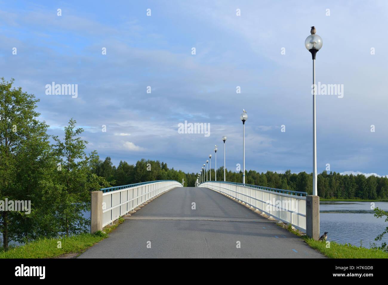 Bridge across river Oulujoki in Oulu, Finland - Stock Image