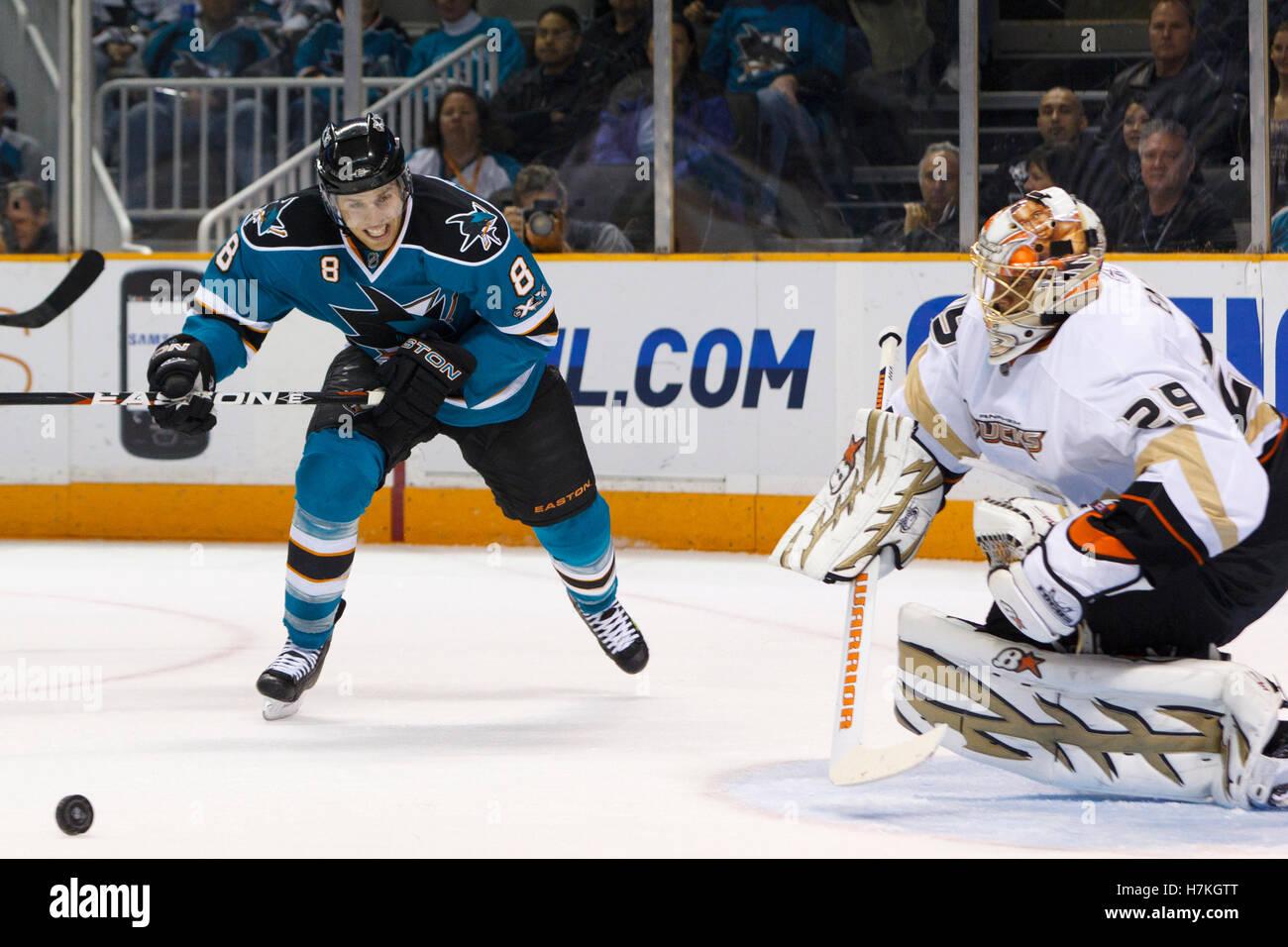 April 2, 2011; San Jose, CA, USA;  San Jose Sharks center Joe Pavelski (8) skates after a loose puck in front of - Stock Image