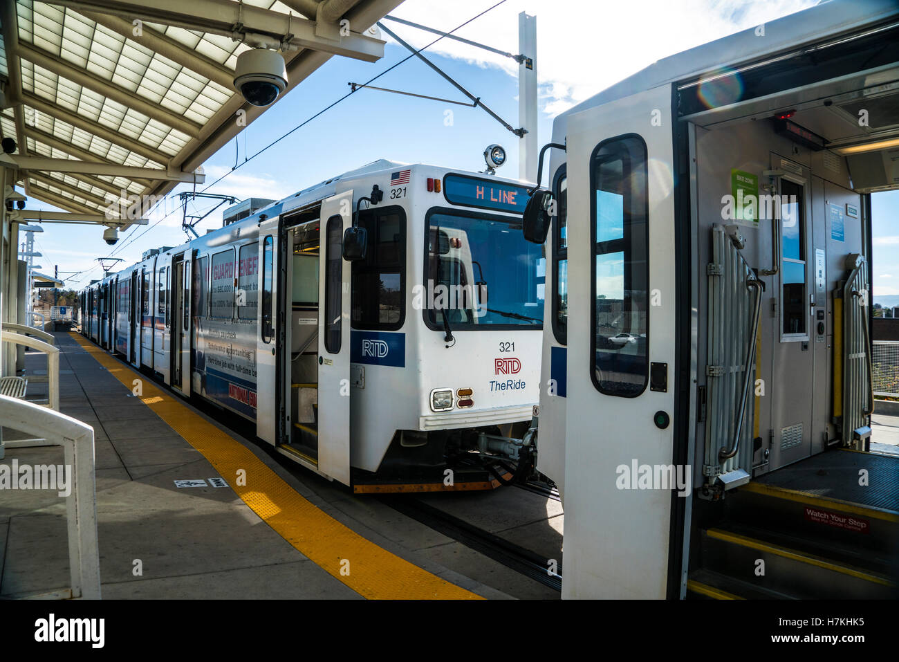 Denver area Regional Transportation District RTD light rail train at Yale station with open doors - Stock Image