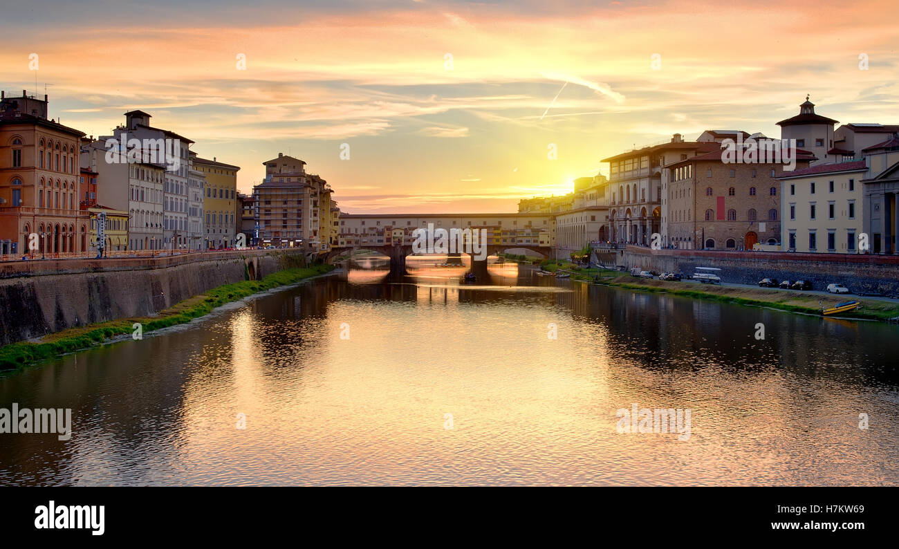 Ponte Vecchio on the river Arno in Florence at sunrise, Italy Stock Photo
