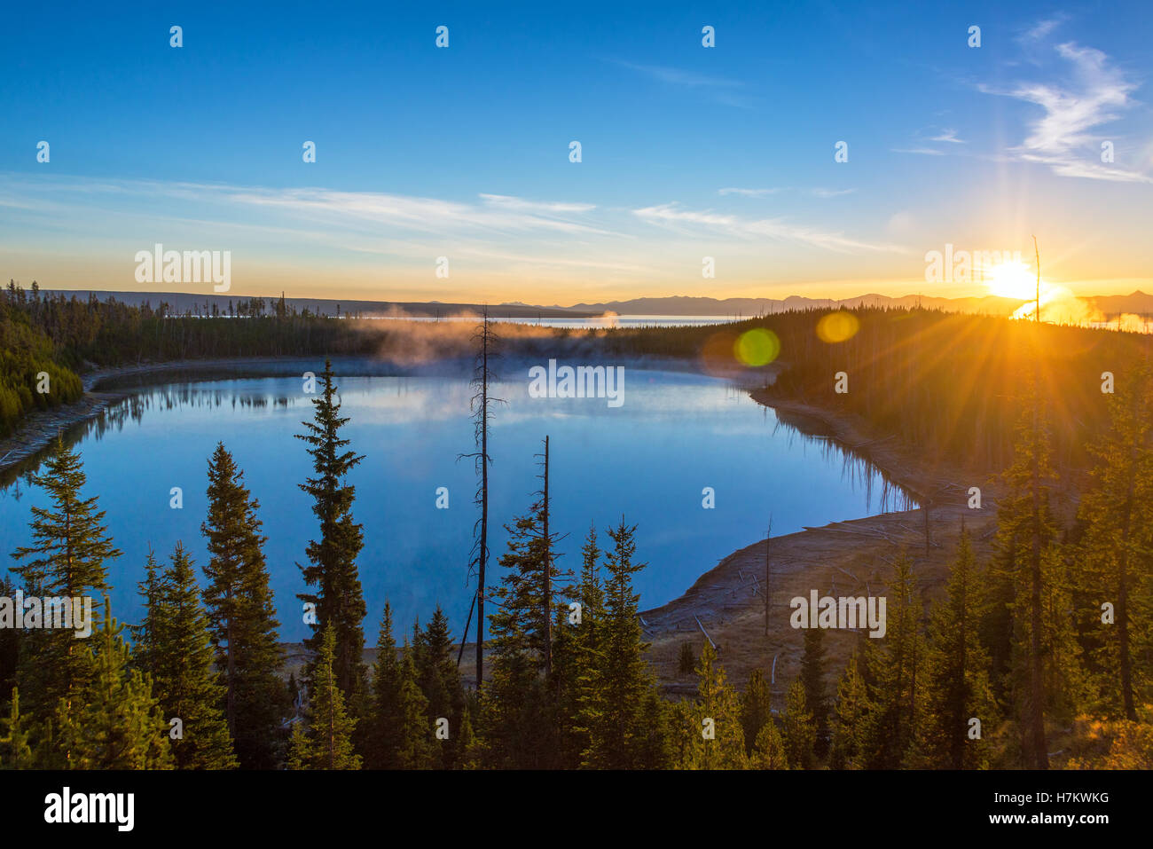 Sunrise over Yellowstone Lake in Yellowstone National Park in Wyoming - Stock Image