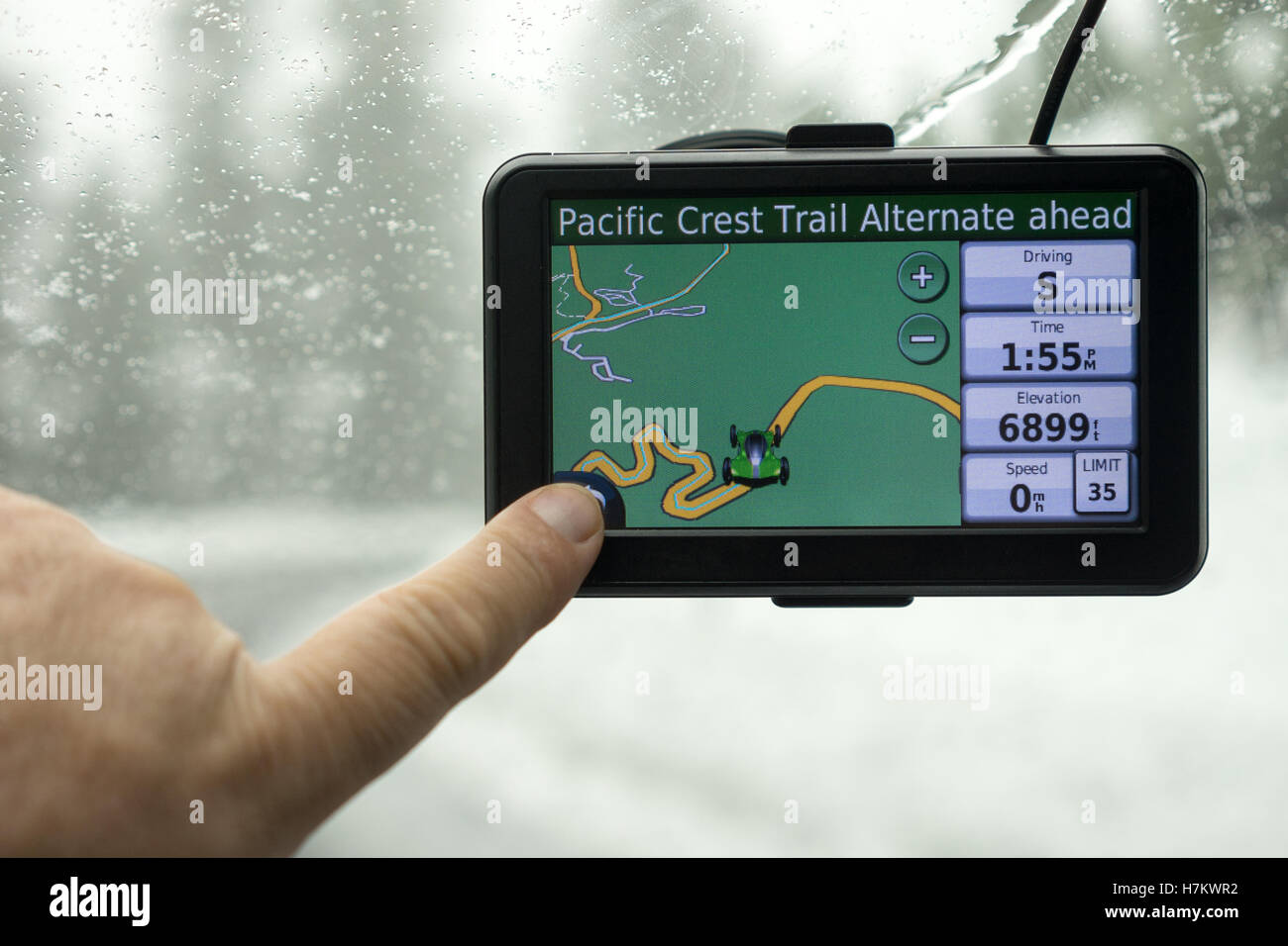 A driver picks a route on his mobile GPS - Stock Image