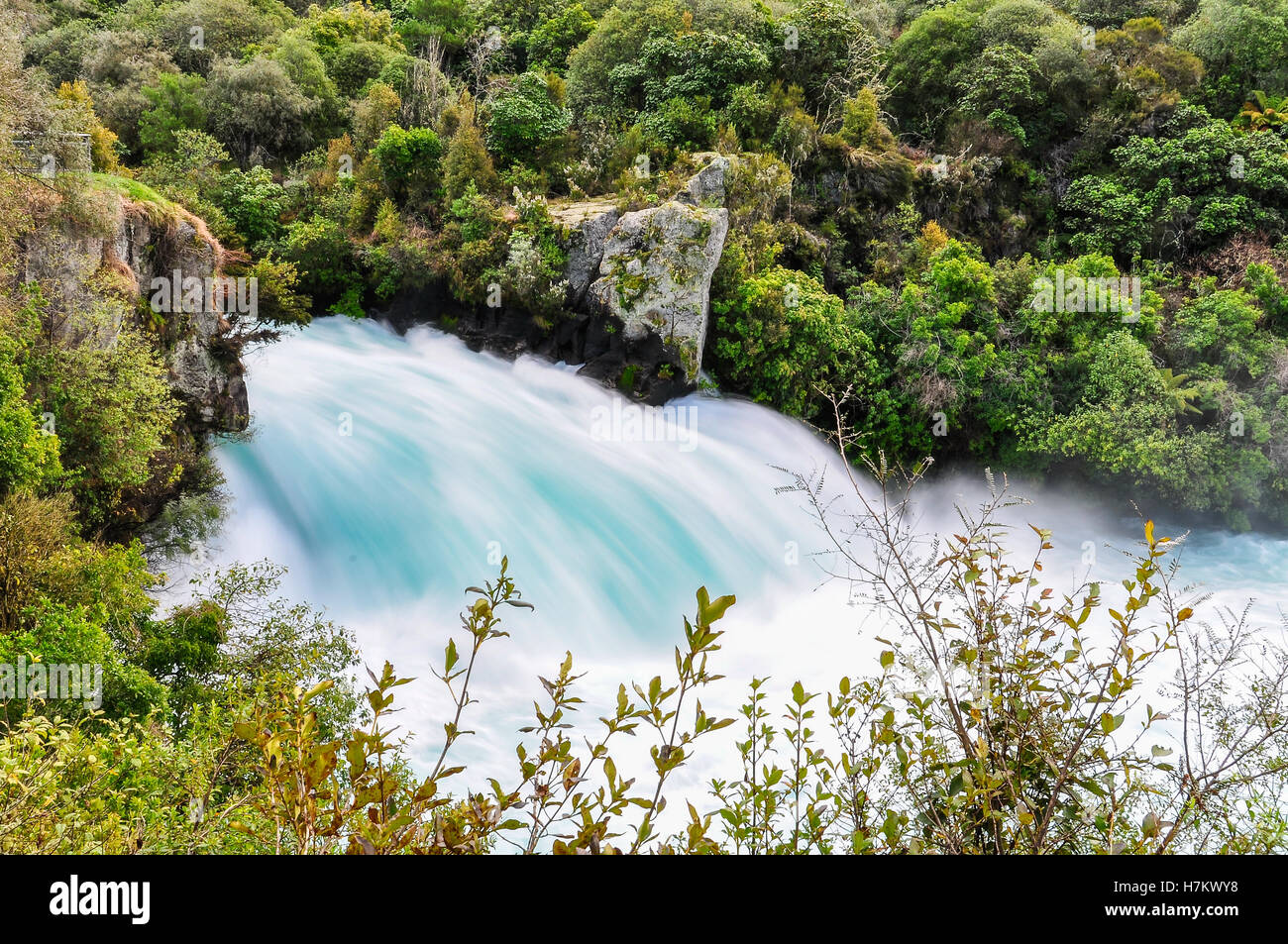 Side view of the rushing wild stream of Huka Falls near Lake Taupo, New Zealand - Stock Image