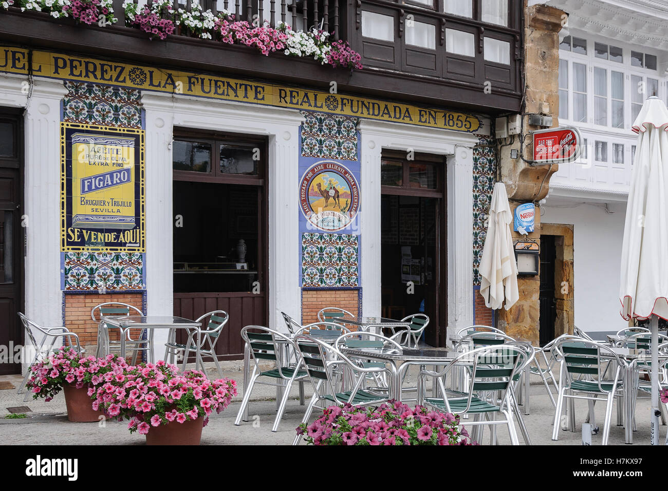 Facade ceramic tiled adverts on the bar La Fuente Real, Comillas, Cantabria, Northern Spain, Europe - Stock Image