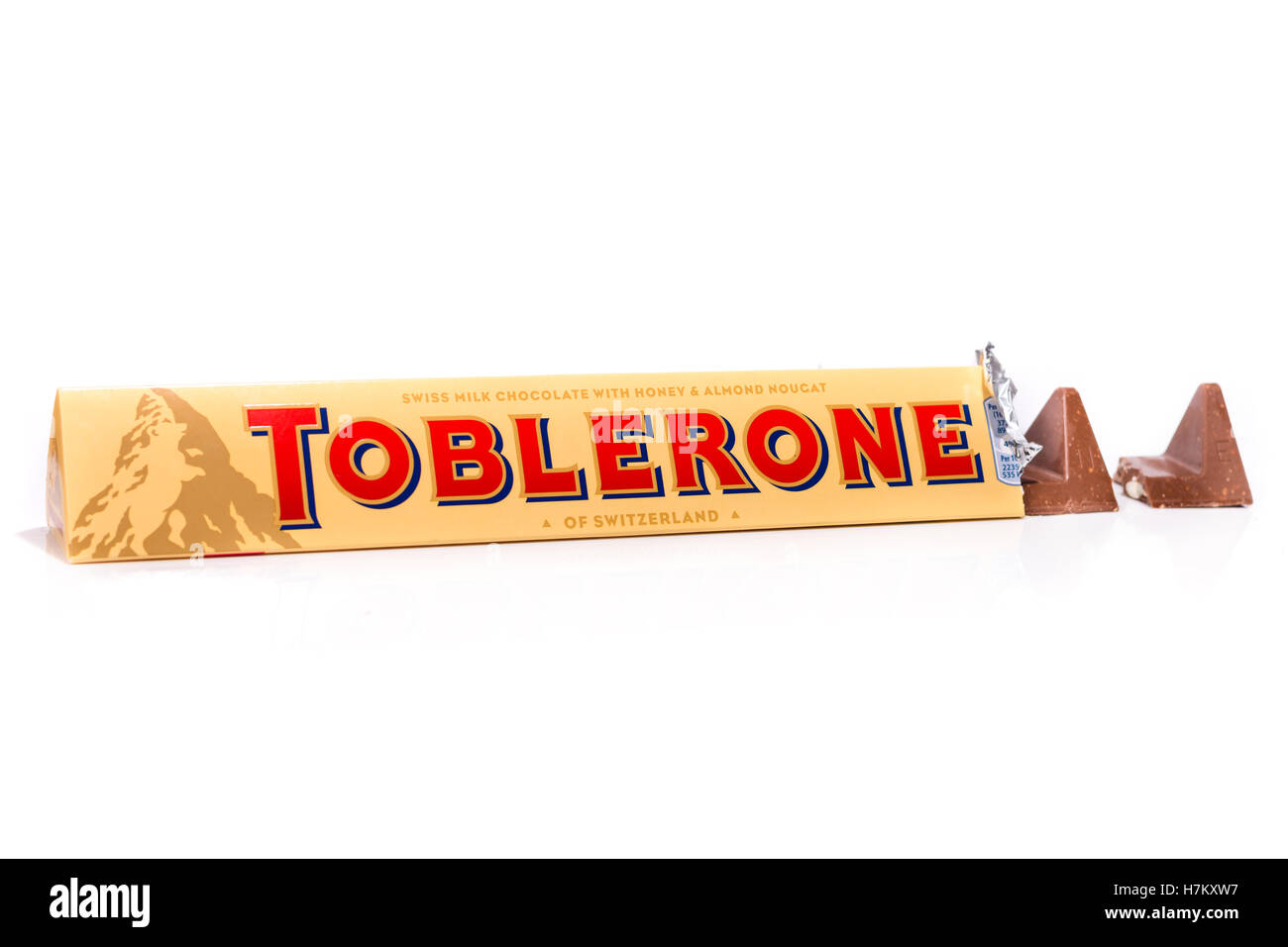 150g Toblerone bar shot on white with separate piece. - Stock Image