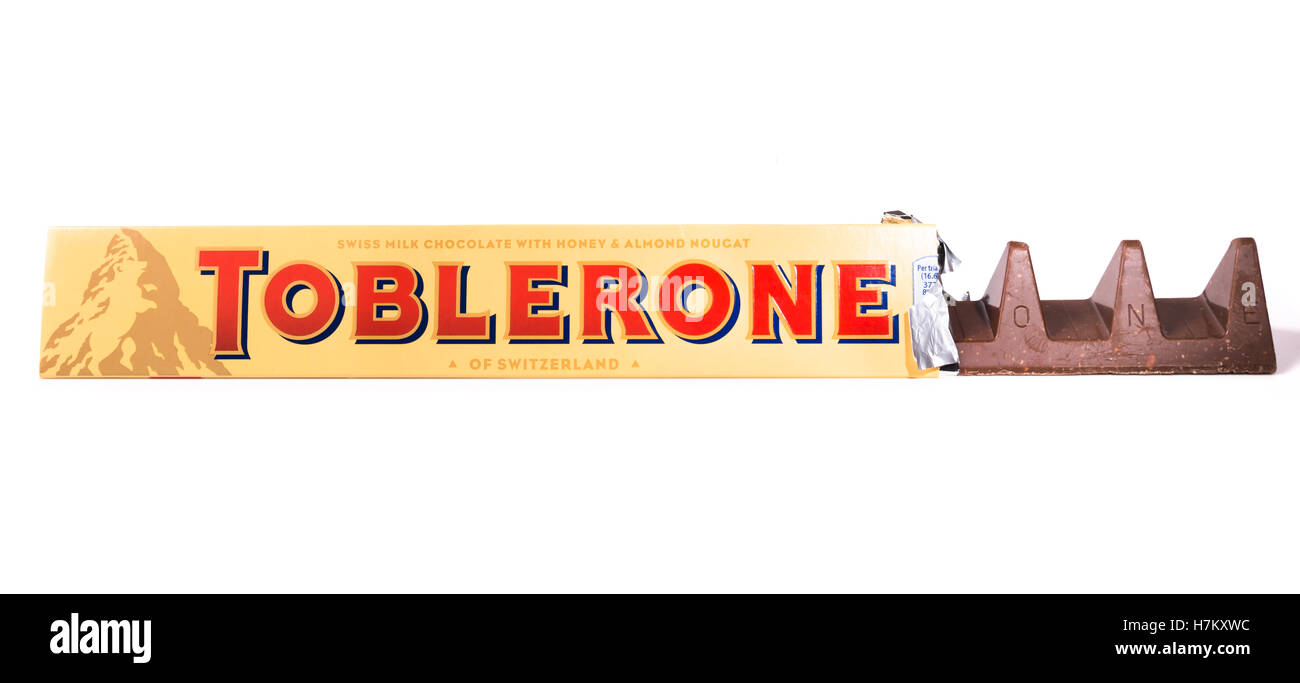 150g Toblerone bar shot on white from front. - Stock Image