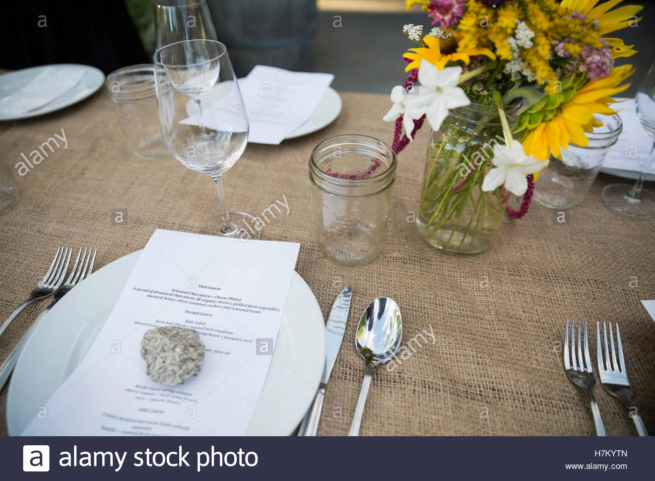 Menu Under Rock On Table At Harvest Dinner Placesetting Stock Photo