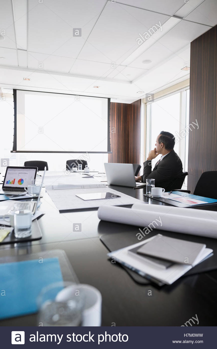 Architect viewing projection screen in conference room - Stock Image