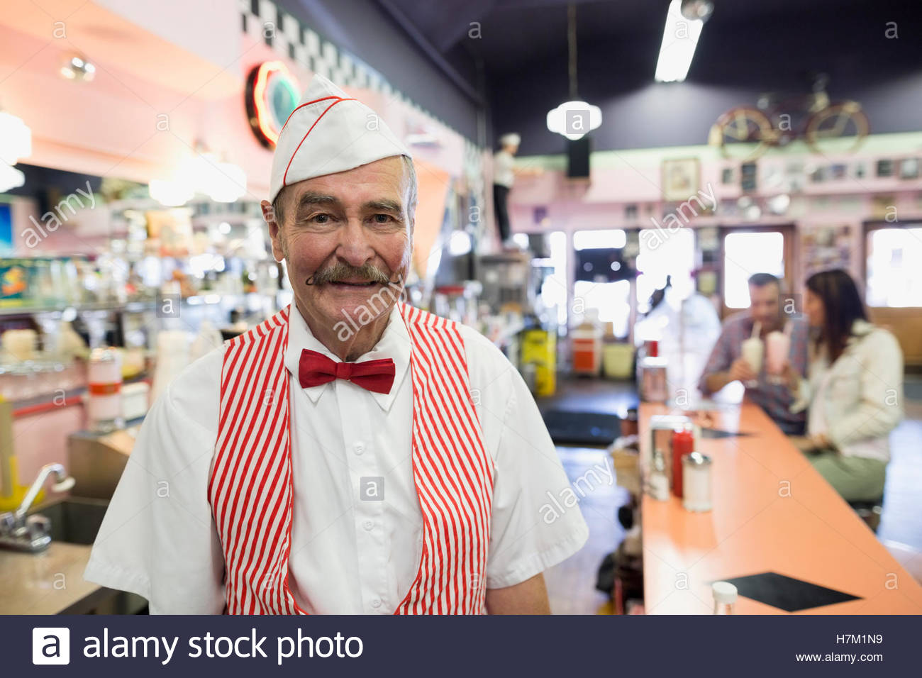 Portrait confident soda fountain shop owner - Stock Image