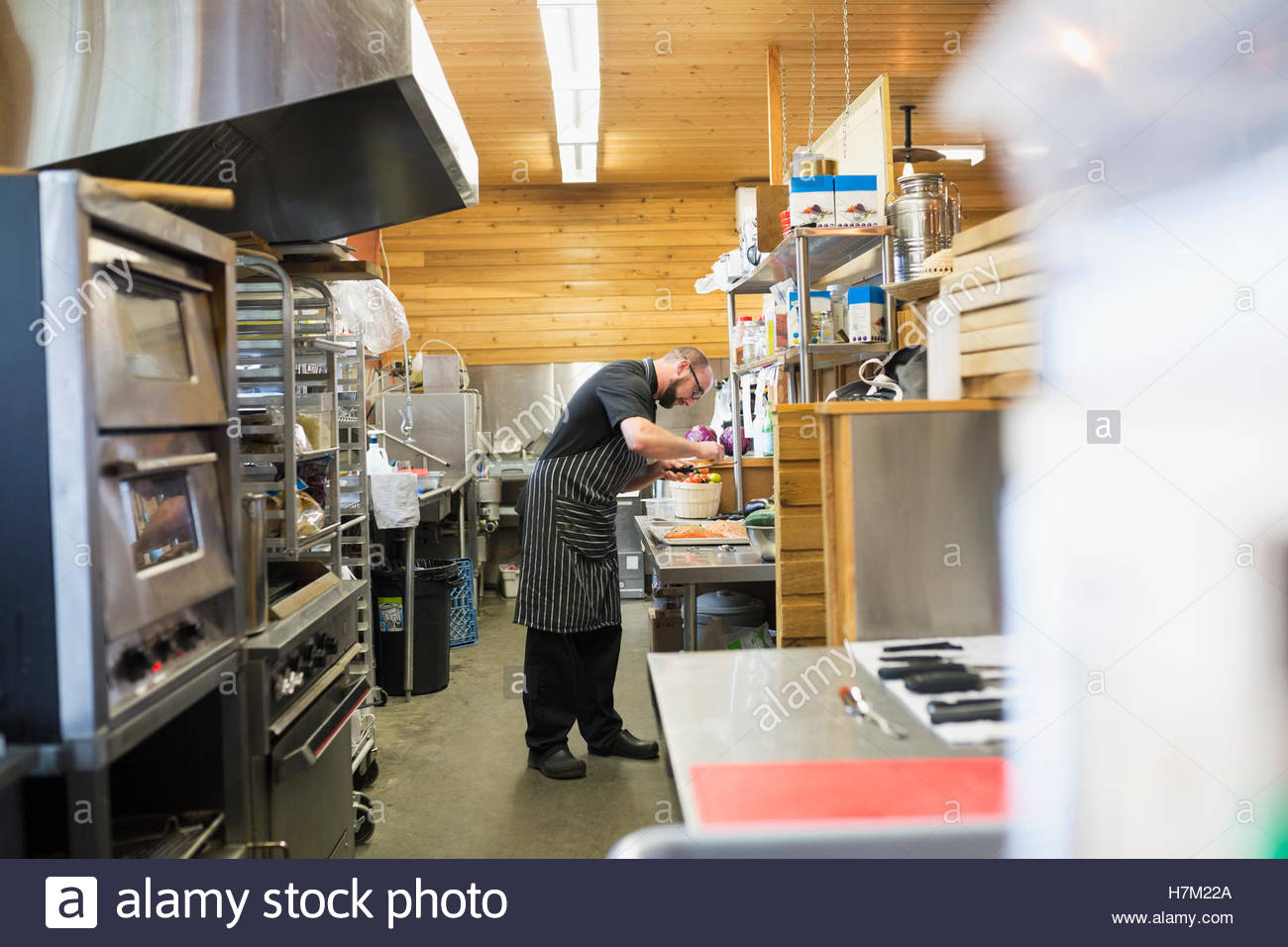 Chef cooking in restaurant commercial kitchen - Stock Image