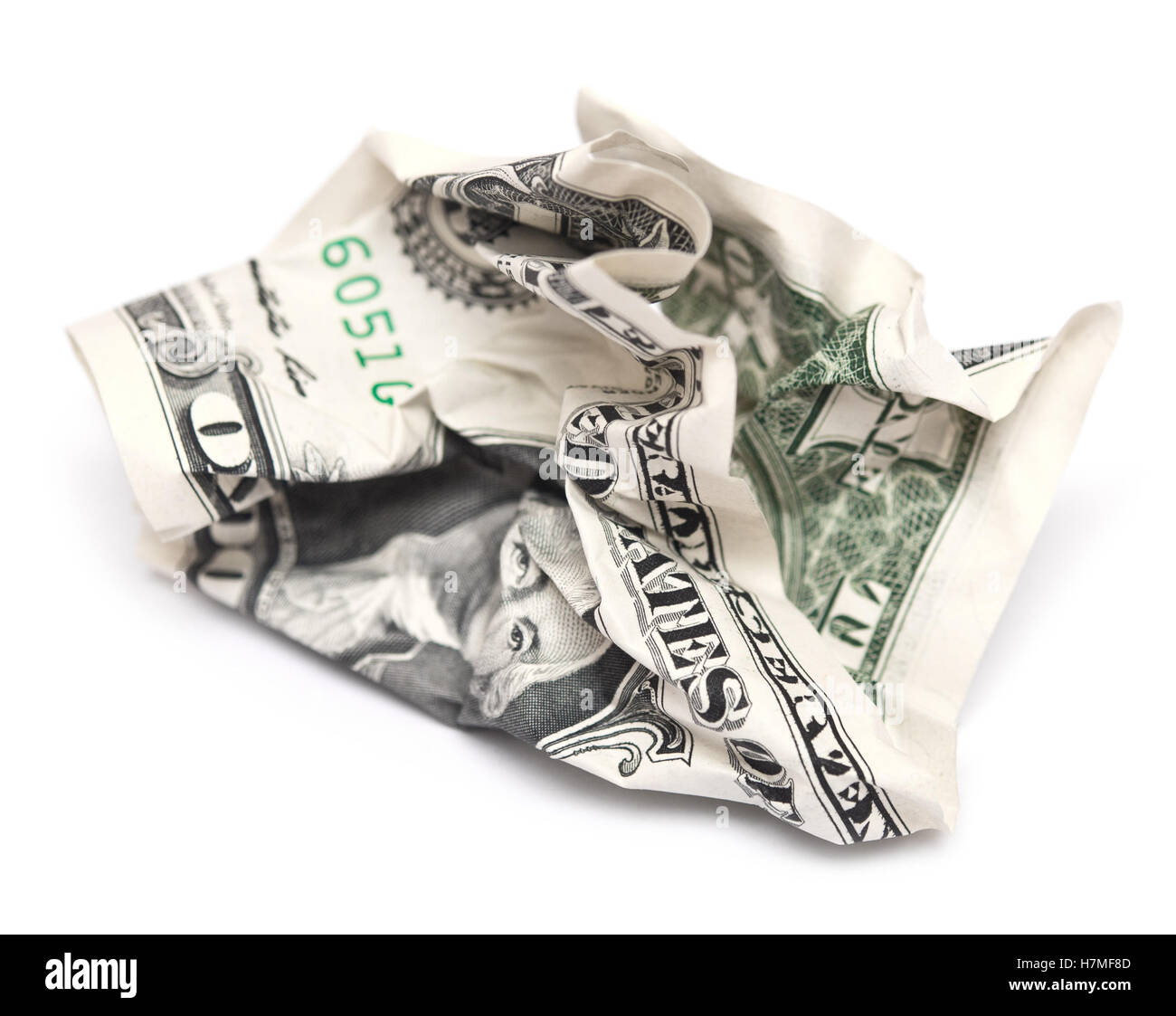 crumpled dollar bill isolated on white background - Stock Image