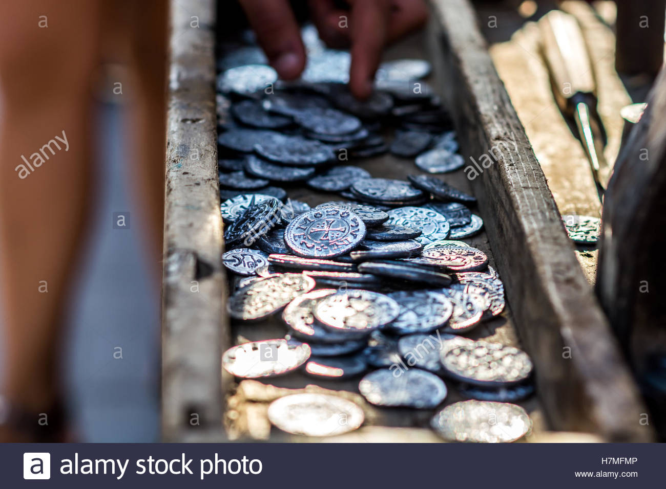 Ancient coins minted shown in a box - Stock Image