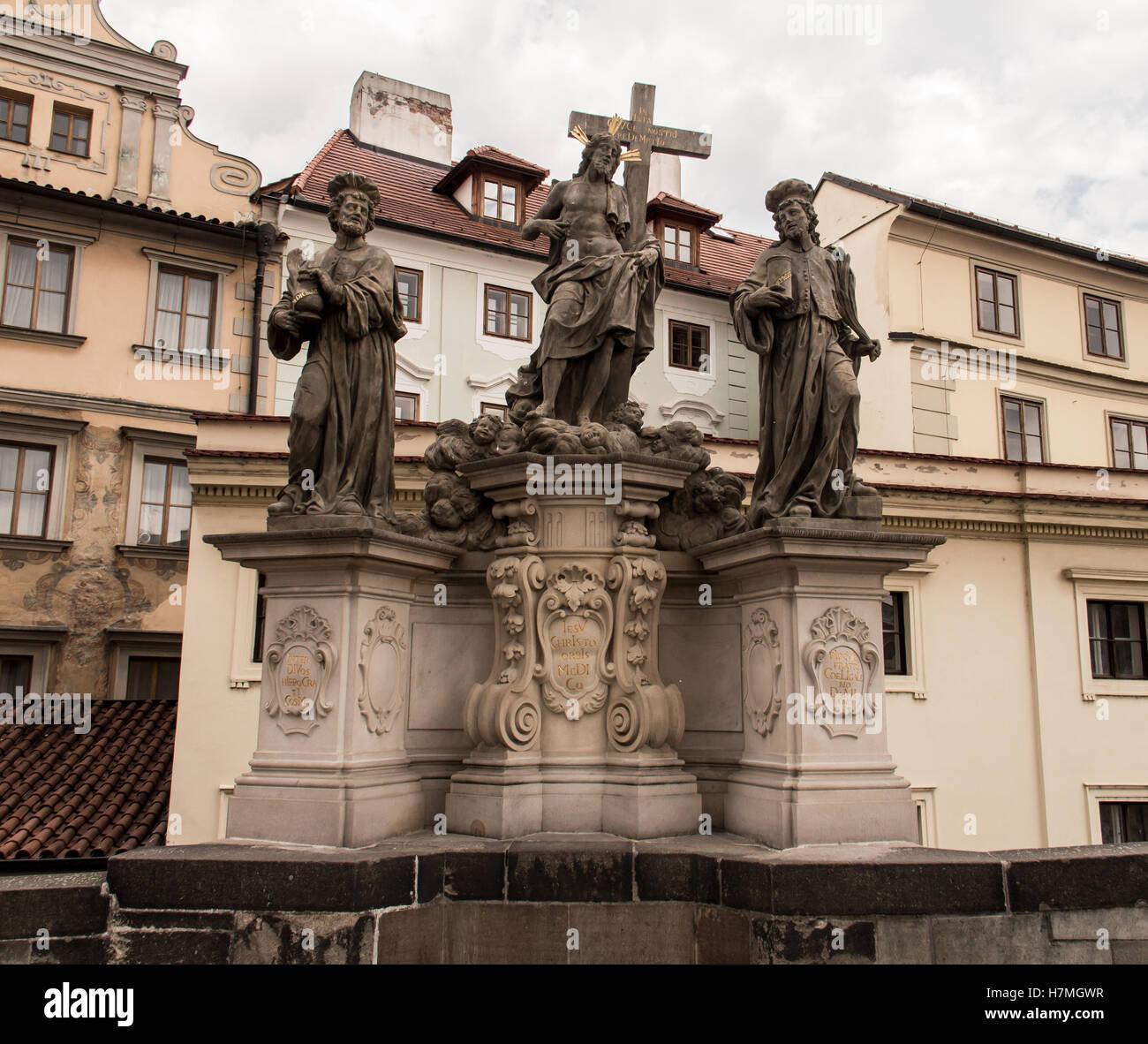 Statuary of Christ the Saviour with St. Cosmas and St. Damian. Statuary of Christ on the Charles Bridge leading - Stock Image