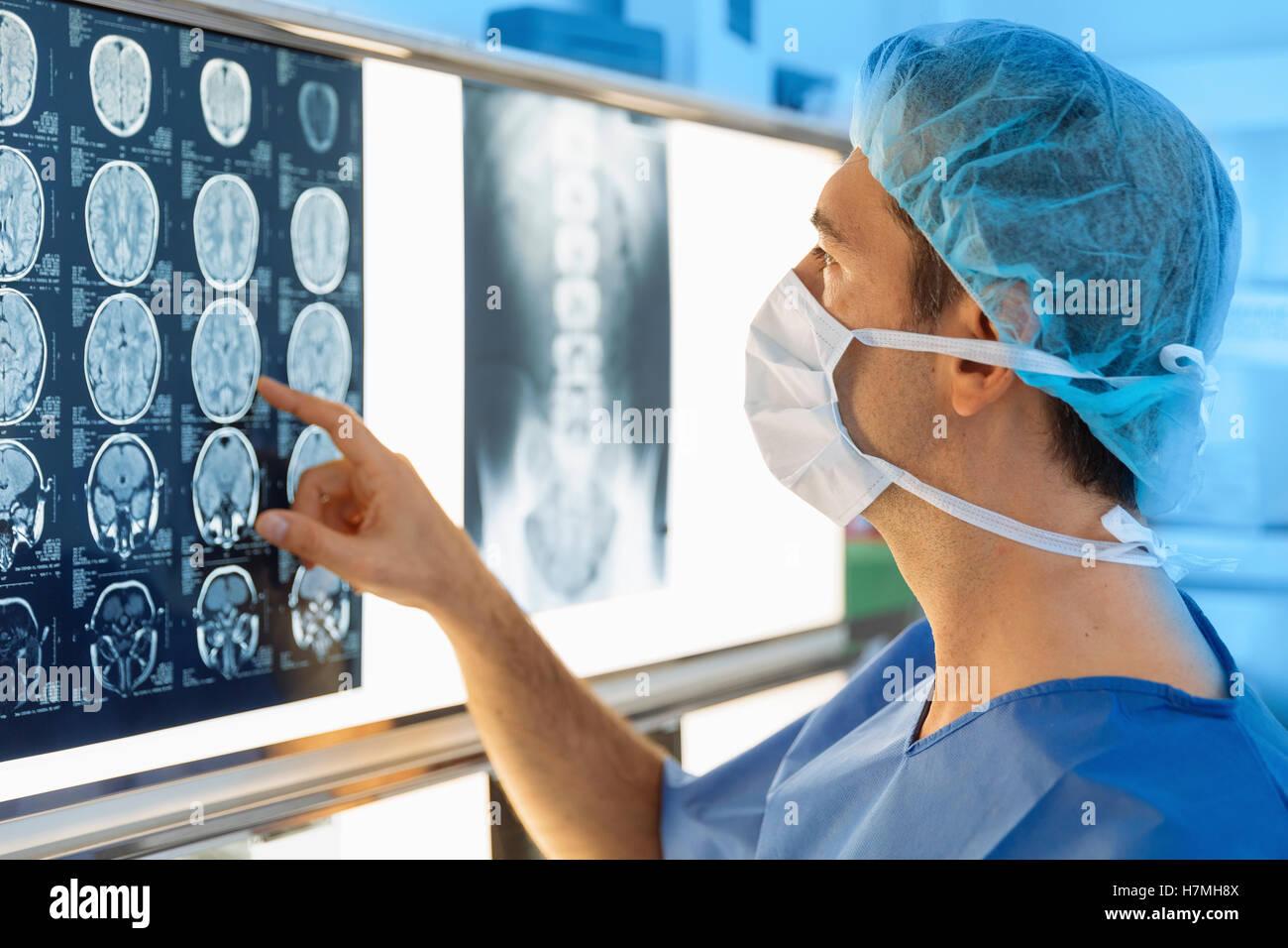 Surgeon examining Xray - Stock Image
