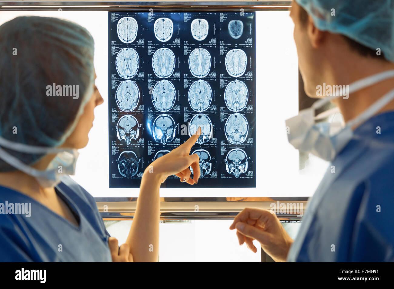 Surgeons examining Xray - Stock Image