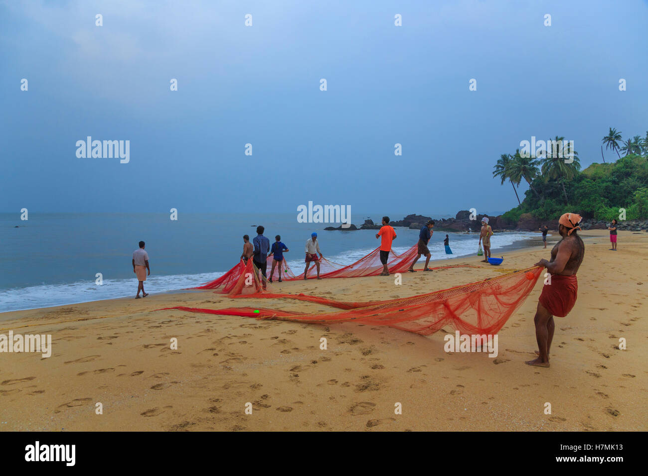 Fishermen at Thottada beach near Kannur Beach (Kerala, India) - Stock Image