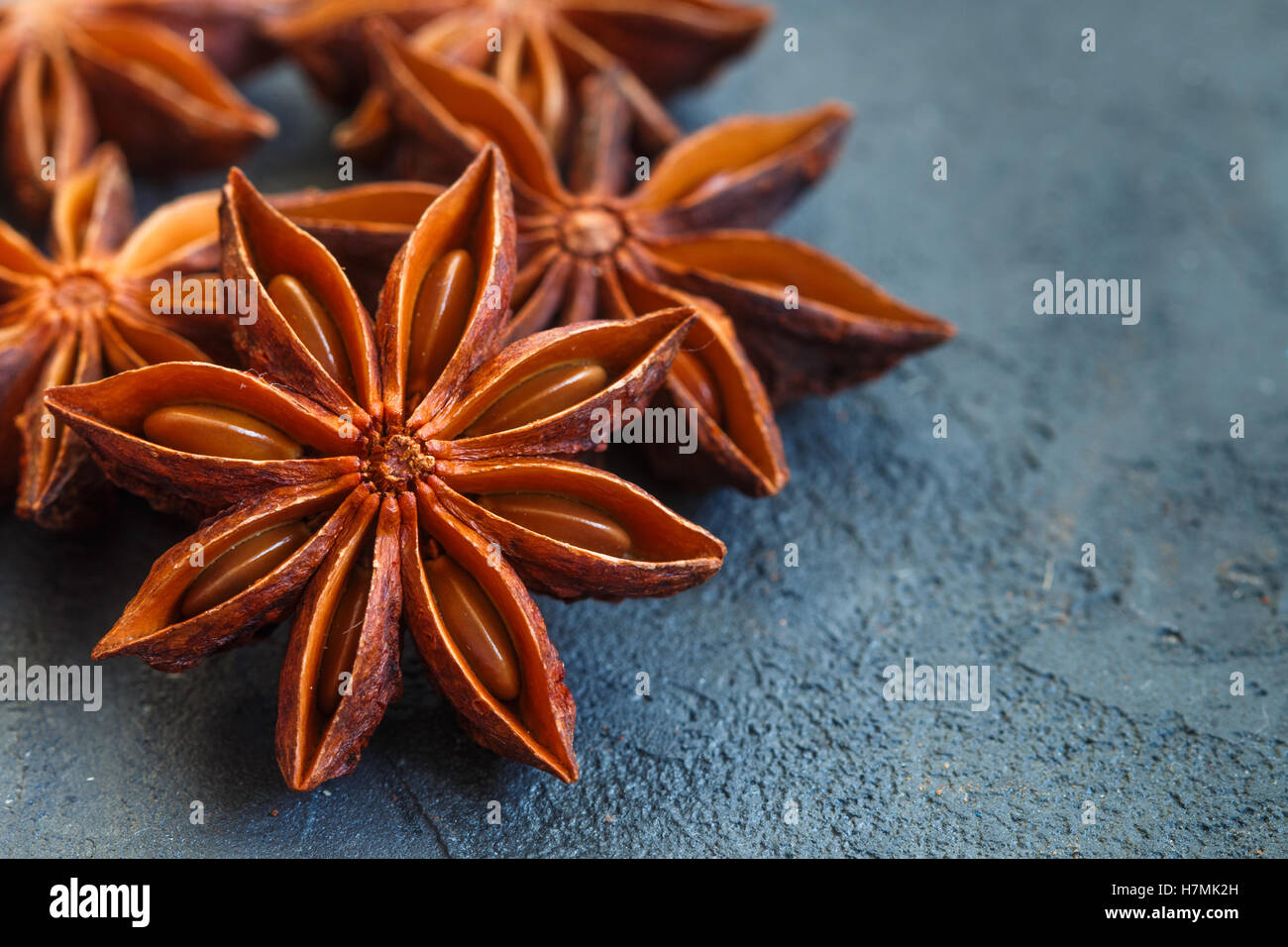 Star anise on black table. Selective focus. Copy space - Stock Image