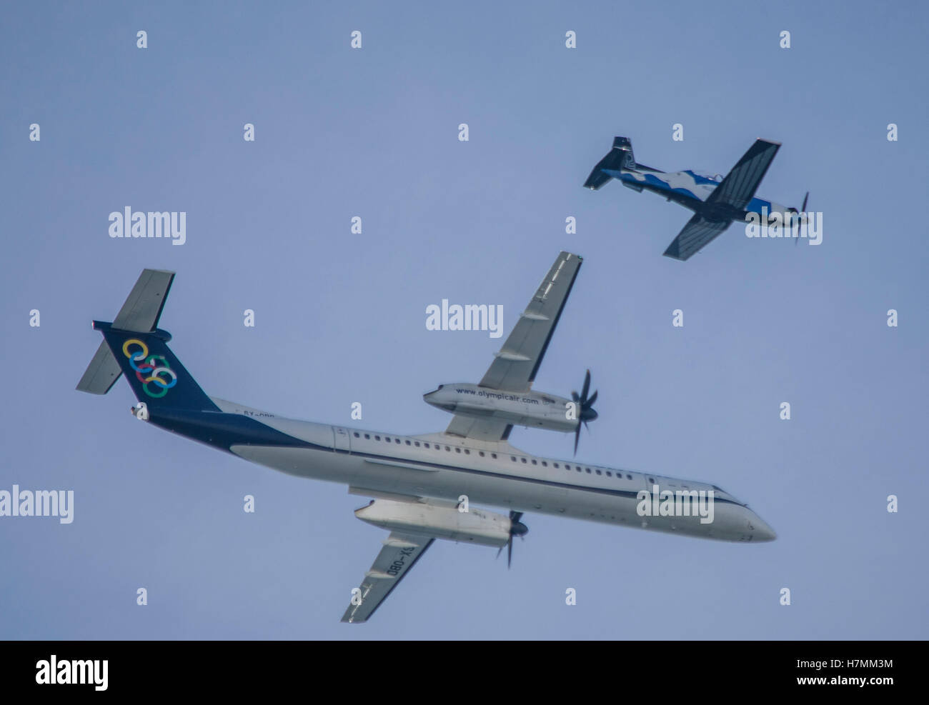 Pireus, Greece. 06th Nov, 2016. An Olympic Air Dash8 Q400 flies together with a HAF T-6 Hexan Deadalus. Hellenic - Stock Image