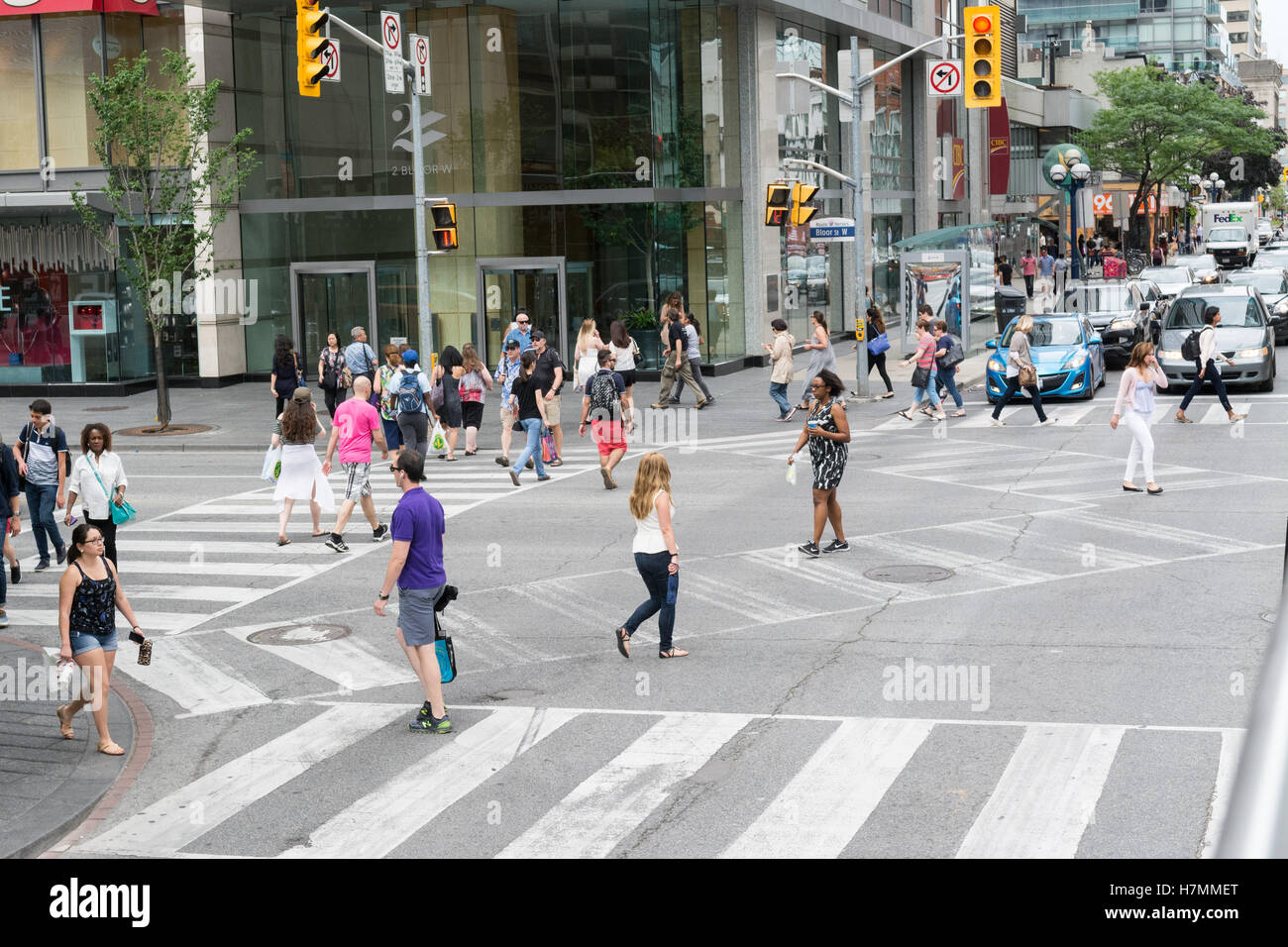 Bloor and Yonge Scramble intersection - pedestrian scramble crossing - Toronto, Canada - Stock Image