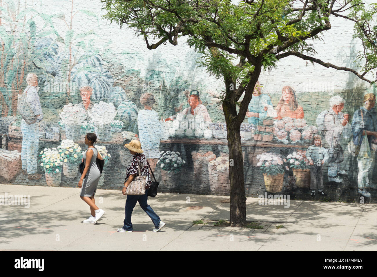 two women walking past St Lawrence Market North mural, Toronto, Ontario, Canada - Stock Image