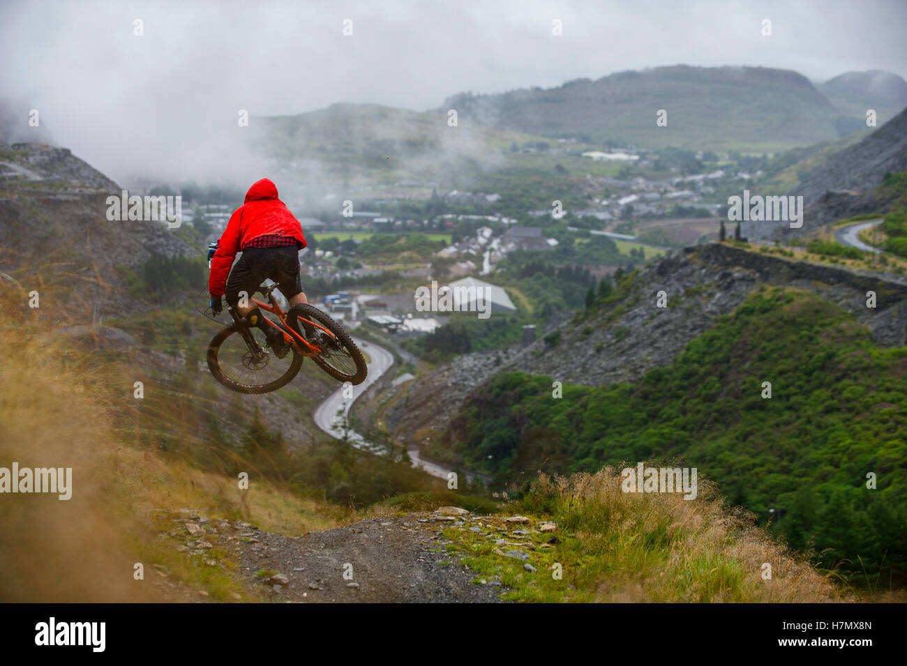 5230d05c83c A mountain biker jumps a rock drop at Antur Stiniog mountain bike centre at Blaenau  Ffestiniog in Snowdonia.