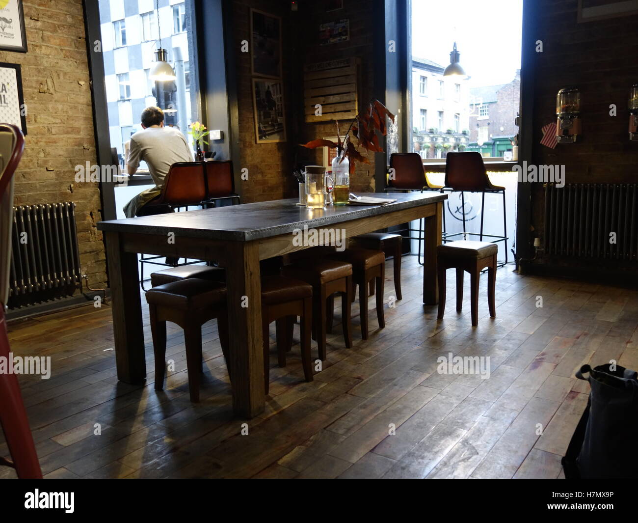 A table in an old atmospheric coffee shop - Stock Image