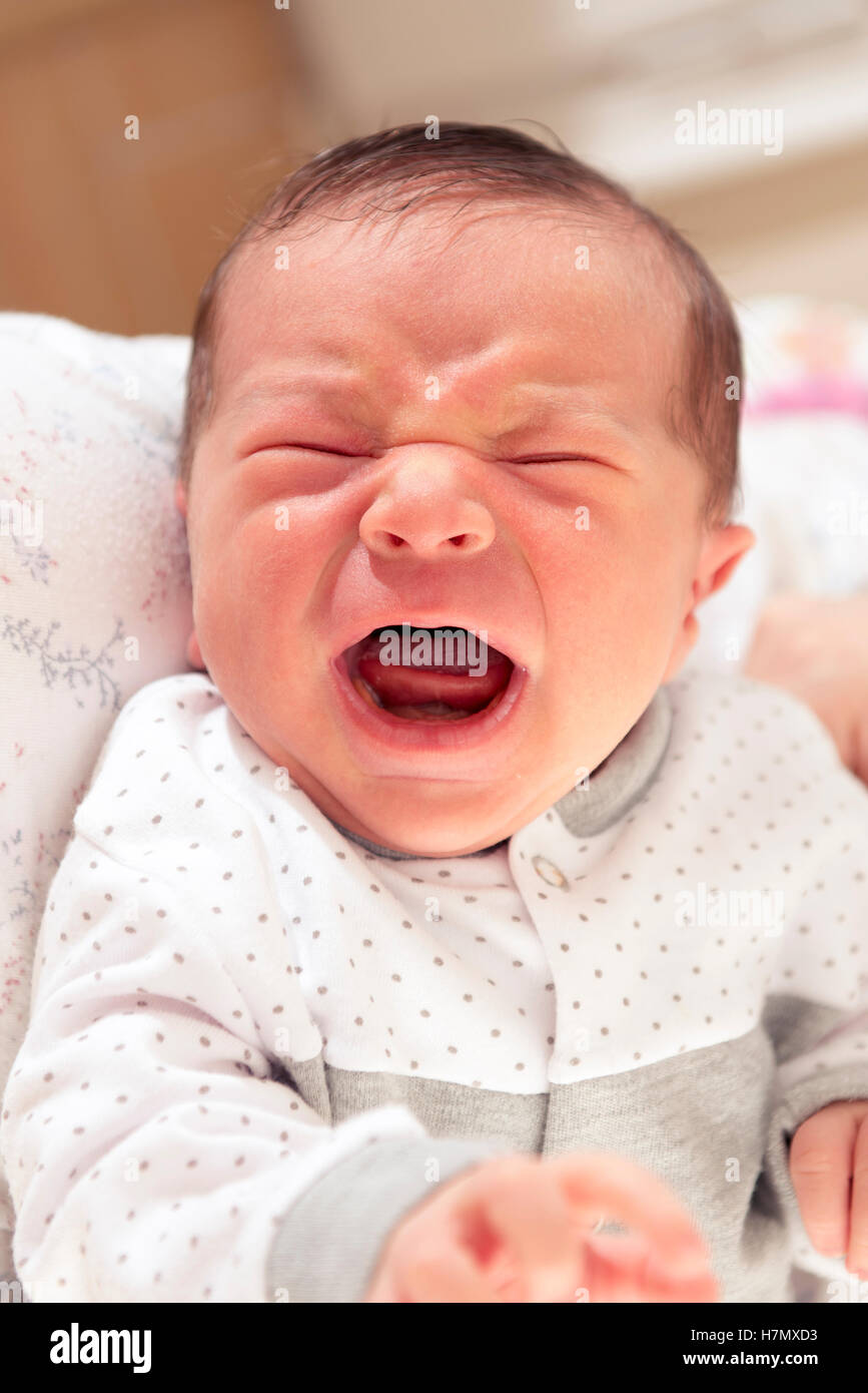 Cute New Born Baby Crying Loudly with Facial Gesture - Stock Image